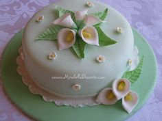 This was my very first fondant cake! Simply decorated with gumpaste calla lilies, little white flowers, and a ruffled border. Beautiful Cake Designs, Beautiful Cakes, Amazing Cakes, Calla Lily Cake, Calla Lilies, Fondant Cakes, Cupcake Cakes, Birthday Cake For Women Simple, Cake Decorating Kits