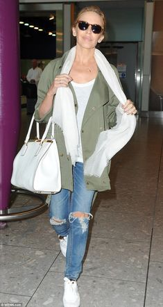 Happy traveller: Kylie Minogue looked radiant as she landed at Heathrow airport on Monday morning