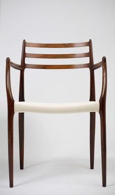 962 Carver Chair by Niels Moller - Vintage Danish Rosewood Moller's 1962 carver is perhaps the the most beautiful, timeless and comfortable dining chair ever made.