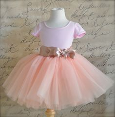 Vintage  pink 8 super fluffy sewn tutu with ribboned waist. First tutu, flower girls or a special birthday.. $78.00, via Etsy.