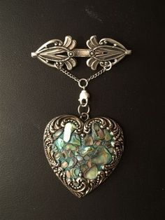 Composed by Andrea Dalen, who collaged the center of the heart with paua shell.