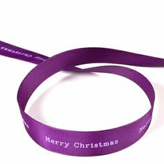MERRY CHRISTMAS - The spices up every Christmas: purple ribbon with lettering Merry Christmas. Pure and sovereign.