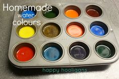 Homemade watercolors using baking soda, white vinegar, light corn syrup, corn starch & food coloring.