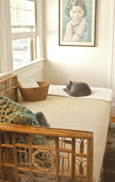 take a lesson from shadow and spend your time snuggled with a good book on the red egg Indochine daybed