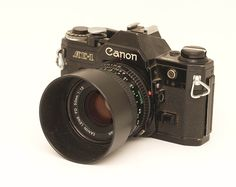Canon AE 1, with some electronics. Saw it first time during the Olympics in Montreal 1976.