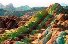 Zhangye Danxia Landform, Gansu Province, China. This naturally-formed landscape - a World Heritage site and a tourist attraction - astonishes visitors with the burst of colors with streaks of yellow, orange and red to emerald, green and blue that make it hard to believe it's real. The formation-process of this geo-park took over 24 million years in the Cretaceous age. If you plan on visiting, hope for the rain, as the vibrant hills glow even brighter after the rainfal - © 2013La boite verte