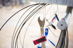 Bicycle repair tools hanging from a stand. http://photodune.net/item/bicycle-repair-tools/3511409