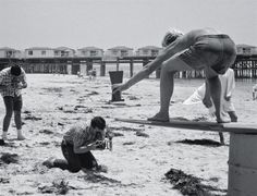Roy Porello (standing with camera), Larry Littlefield of The Sentinel (kneeling with camera), surfer Skip FryeMission Bay Aqua Fair Surf Contest, Crystal Pier, Pacific Beach, Sandiego, CA, Memorial Day weekend, 1963. Photo: Ron Church