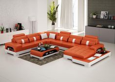 The Connie sectional sofa features a side light, side shelving, and a small side table. It is handmade with genuine Italian leather and is one of Opulent Items' most popular models.