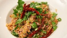 Rice balls and sour pork salad (nam khao with som moo) recipe : SBS Food