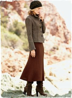 An Italian chevron tweed tailored with dimensional princess seaming and a peplum hem for a shapely jacket silhouette. With fit-and-flare midi skirt and tall ruched boots. By Peruvian Connection.