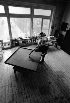 Ad Reinhardt in his New York Studio in the 1960s. The artist worked flat, brushing and rebrushing the surface to remove all traces of the stroke.