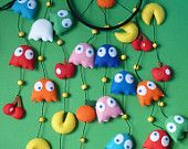 Felt mobile with the characters of Pacman.  Exclusive design.  Light, to hang a curtain rod or hook to the ceiling.  Measurements from the green circle: 44 x 17 cm  Not a toy, for decoration only.  Each mobile is unique, no two alike.  Ready to ship.