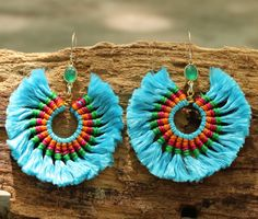 Blue cotton tassel earrings in circle shape with green onyx in gold bezel setting and silver hooks
