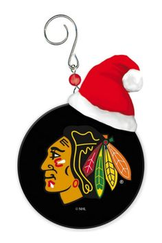 """No Chicago Blackhawks fan's Christmas tree is complete without their favorite team! This mini puck Christmas ornament features the Blackhawks logo and is accented with a mini Santa hat. Ornament measures 2.76"""" x 3.23"""" x 1.85"""" and is definitely a die-hard Blackhawks fan must have! Blackhawks Puck Ornament by Evergreen Enterprises. Home & Gifts - Home Decor - Holiday River North, Chicago, Illinois"""