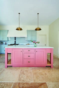 Paint a kitchen island in an eye-catching hue for a colourful contrast. Bespoke handmade kitchen from Barnes of Ashburton. For more kitchen styling updates look out for the July copy of The English Home magazine. Kitchen Wall Cabinets, Kitchen Cabinet Design, Kitchen Island, Kitchen Paint, Pink Kitchen Walls, Kitchen Colors, Kitchen Decor, Kitchen Ideas, Indian Home Interior