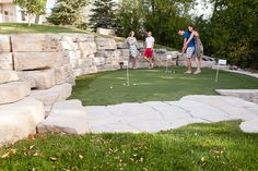 The impressive Outcropping walls create a backdrop for this patio mini golf course. Precast Concrete, Flagstone, Natural Looks, Outdoor Living, Backdrops, Golf Courses, Sidewalk, Walkways, Garden