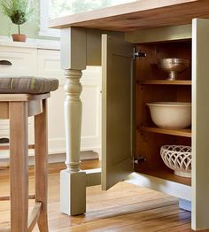 A cabinet that's positioned deeper into an island is out of the way but still close at hand, which is good for infrequently used dishes and kitchen gadgets.