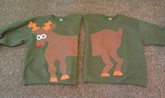 Matching Christmas Ugly Reindeer Sweaters.