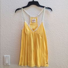 Hollister top in a sweet yellow Sweet yellow Hollister tank. Worn once and in like new condition. Hollister Tops Tank Tops