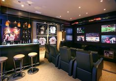 Basement with sports themed room with very cool wall of TV's