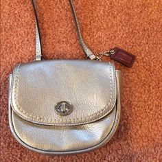 Silver Metallic Grey Coach Cross Body Purse Great for a special occasion like prom, a wedding, formal, or even just a night out! Looks great with any outfit to hold just a few important things. Two inside pockets & one back pocket. Very slight sign of wear on the inside (see picture) but nothing noticeable when wearing. Nice addition to any closer!! Coach Bags Crossbody Bags