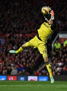 Thibaut Courtois of Chelsea in action during the Barclays Premier League match between Manchester United and Chelsea at Old Trafford on October 26, 2014 in Manchester, England.
