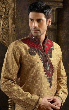 Kazim - I don't like brocade. But the top embroidery is nice. Embroidered sherwani.