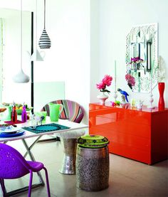 bright, eclectic, different..  I like the purple chair, the striped chair and the metal stools