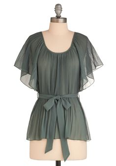 sage, sheer, accordion pleating, fluttering sleeves, and tie sash that cinches this tunic-length look.