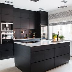 dark gray flat front kitchen cabinets with gray mosaic tile