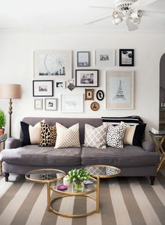 Fun pillows and wall art in living room to make a statement
