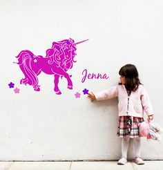 Unicorn wall decal with name for girly room - with flowers and personalized name - removable vinyl sticker. $24.00, via Etsy.