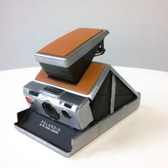 Product Specifications • Restored Polaroid™ SX-70 camera • Type: Folding SLR instant camera • Lens: 4-element 116mm f/8 glass lens • Minimum focus: 10.4 inches • Aperture: Aperture range f/8 &…