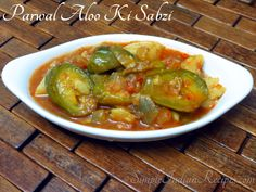 Aloo Parwal Ki Sabzi is a commonly made side dish in northern and eastern states of India. Parwal is also known as Patol or Pointed gourd. Indian Vegetarian Dishes, Easy Indian Recipes, Fried Potatoes, Garam Masala, Easy Cooking, Gourds, Curry, Tasty, Simple