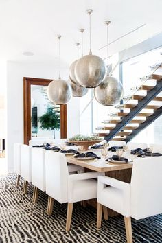 In a sleek, sophisticated dining room, Moroccan pendant lights give coastal style a unique twist. A little bit of boho influence and some asymmetry let these lights shine as the focal point of the...
