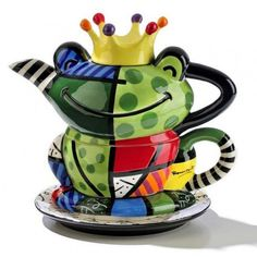 Romero Britto teapots are top of line when it comes to style and art. These exquisite Romero Britto teapots are for sale at the best prices on. Tea For One, My Tea, Britto Disney, Frog Tea, Teapots Unique, Garden Parties, Tea Pot Set, Teapots And Cups, Mad Hatter Tea