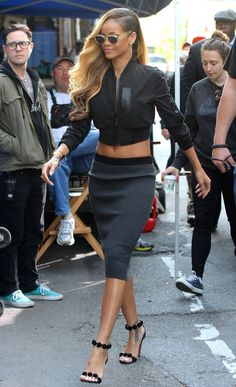 RiRi in a cropped jacket and slinky ribbed skirt by Louise Goldin.