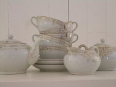 Antique Nippon tea set in white porcelain with handpainted gold floral design
