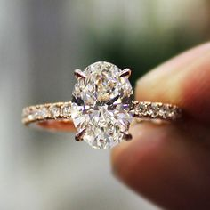 Simply stunning This 2.31 Ct. Oval Cut Pave Diamond Engagement Ring is a definite showstopper! Check out our store's website for more gorgeous rings like this one!