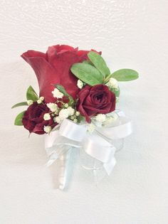 Magnetic corsage of red Sweetheart and spray roses with babies breath and boxwood from Seasonal Celebrations.