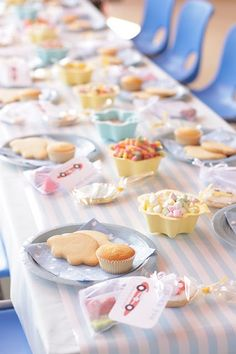 Table set up so kids can decorate their own cupcakes and cookies