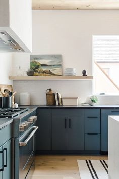 Kitchen Lighting Kitchen - The Naturally Danny Seo House in Serenbe by R. Blue Kitchen Cabinets, Painting Kitchen Cabinets, Kitchens Without Upper Cabinets, Kitchen Artwork, Green Cabinets, Kitchen Photos, New Kitchen, Kitchen Decor, Kitchen Wood