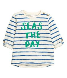 Natural white/blue stripe. Long-sleeved T-shirt in soft slub cotton jersey with a printed motif at front. Buttons on one shoulder and sleeves with roll-up