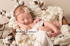 Amarillo newborn photographer | Organic newborn photography. Fine art newborn photography. Newborn baby girl surrounded by cotton.