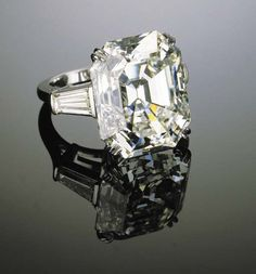 A MAGNIFICENT DIAMOND RING   Set with a rectangular-cut diamond weighing 27.02 carats to the tapered baguette-cut diamond shoulders and platinum hoop