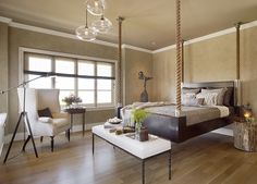 Master bed suspended by rope, as seen in Traditional Home.