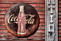 rusted and weathered Coca-Cola sign on an antique store in Leipers Fork, TN