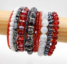 This ravishing red multi-wrap bracelet is made on 11 rows of silver memory wire and is filled with glass beads, silver spacer beads, various crystals, and Snowflake Obsidian tube beads and is perfect for beautiful everyday wear any time of the year or great as an accessory for this