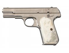 Excellent Nickel Plated Colt Model 1908 .380 Semi-Automatic Pistol with Pearl Grips. Beautiful piece.